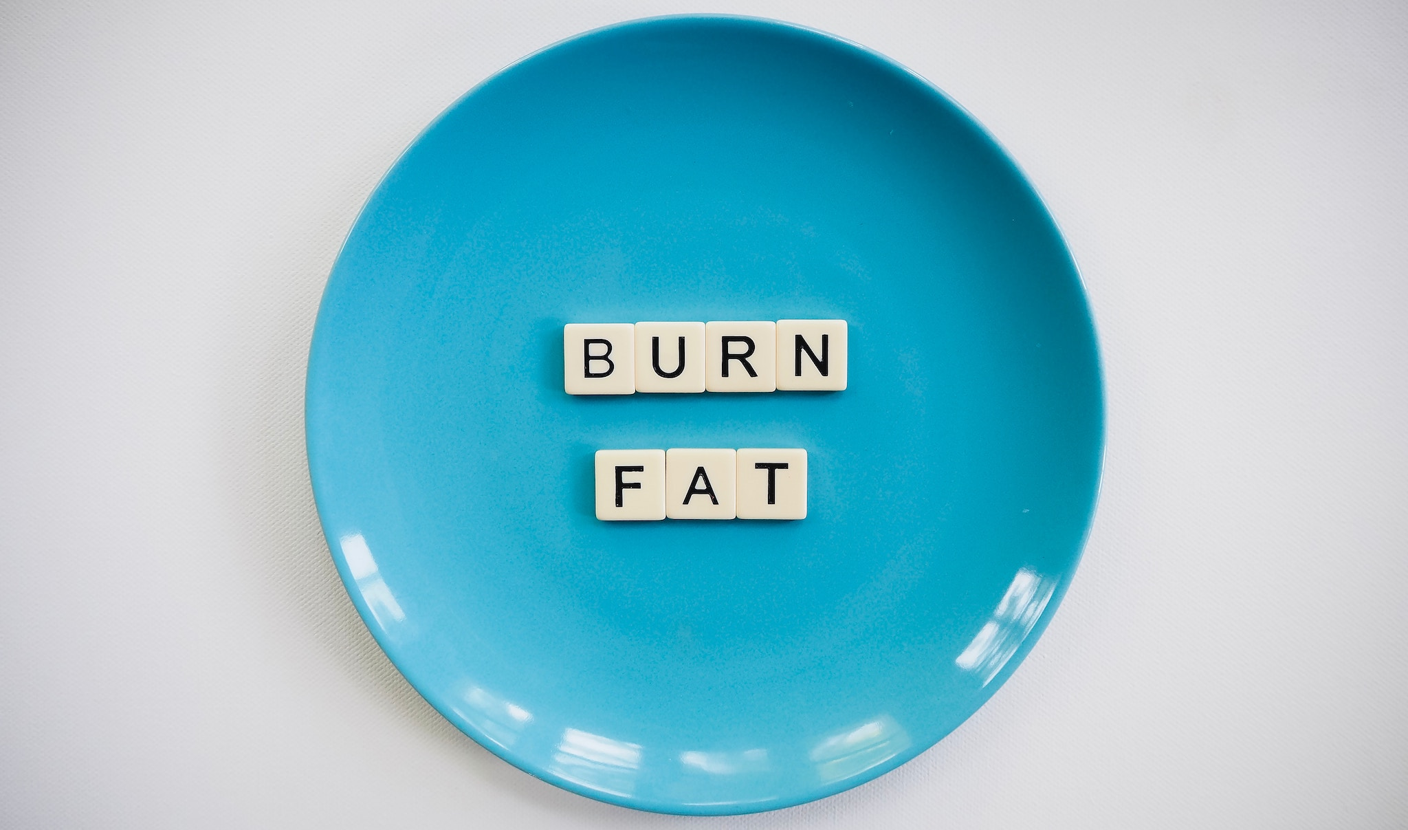 Plate with letters that spell BURN FAT