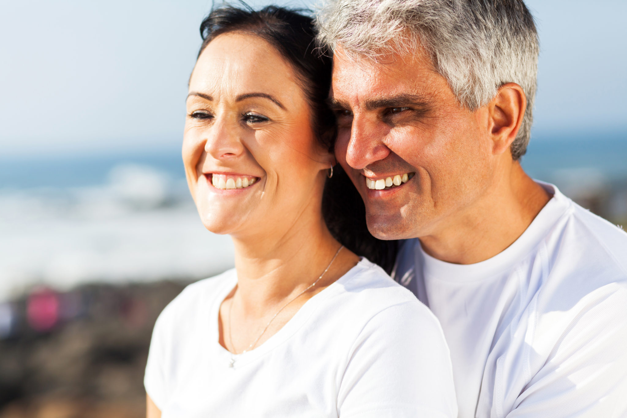 hormone replacement therapy: older man and woman smiling with vigor